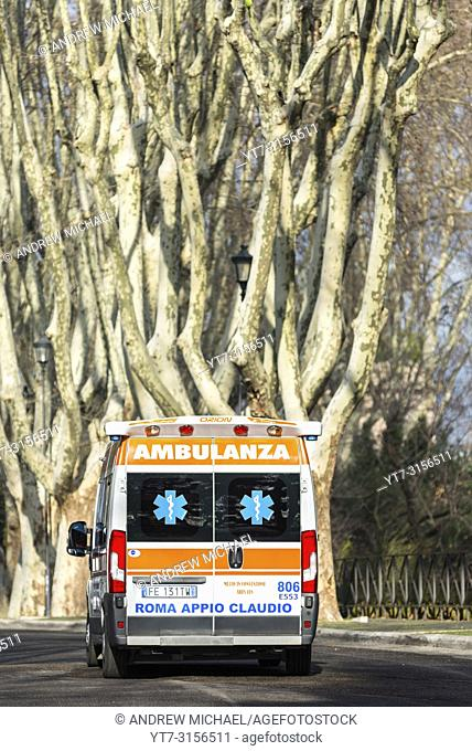 An Ambulance passes Bare Plane trees lining the Passegiata Di Gianicolo on Janiculum hill (2nd highest in Rome) a. k. a. Monte del Gianicolo, Italy