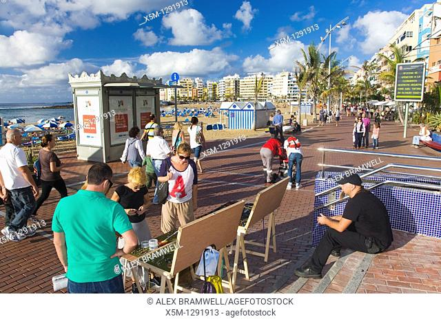 Canteras beach viewed from the promenade with a market stall in the foreground. Las Palmas, Gran Canaria, Canary Islands