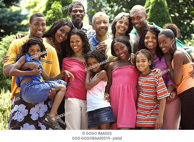 Extended African family smiling together
