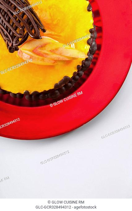 Chocolate garnish on a lemon flan cake