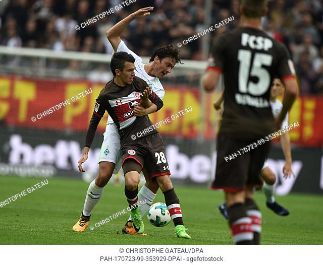 Bremen's Thomas Delaney and St. Pauli's Waldemar Sobota vie for the ball during the test match between FC St. Pauli and Werder Bremen at the Millerntor Stadium...