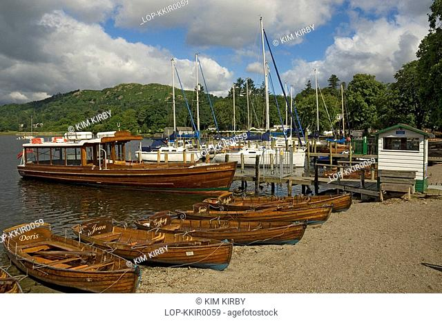 England, Cumbria, Ambleside, Wooden boats beached ready for hire on Lake Windermere