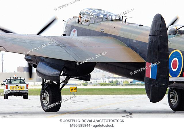 Avro Lancaster bomber following truck for takeoff at airshow. Windsor, Canada