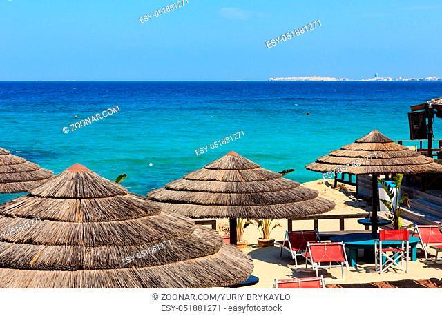 Picturesque Ionian sea beach Punta della Suina, Salento, Puglia, Italy. Gallipoli town view in far