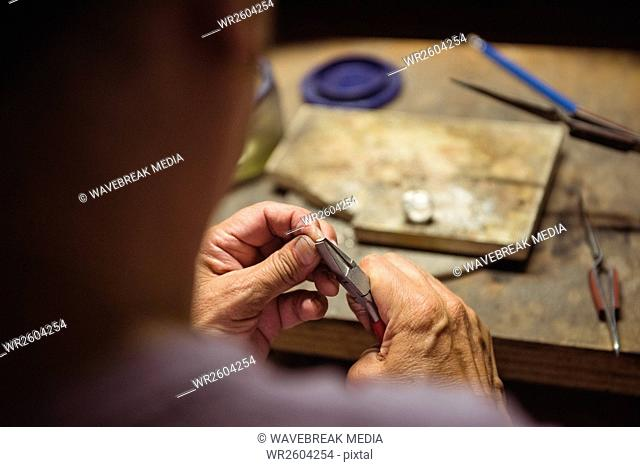 Craftswoman using pliers