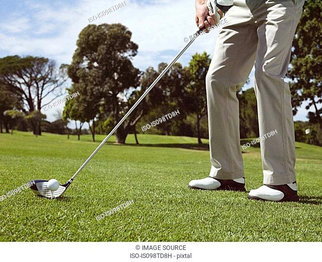 Man playing golf on golf course