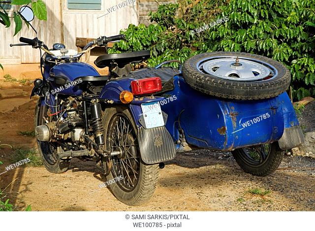 Old classic motorbike with a sidecar parked in a garden, Vinales, Pinar del Rio Province, Cuba