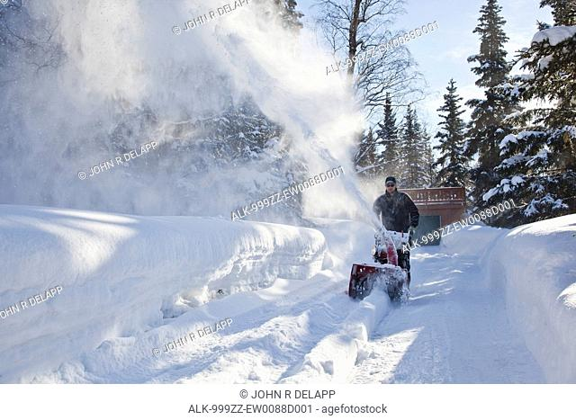 Driveway snow blower Stock Photos and Images | age fotostock