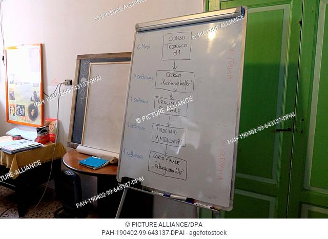 02 March 2019, Italy, Crotone: The course structure is written on a blackboard in a course for Italians who later want to work as nurses or paramedics in...