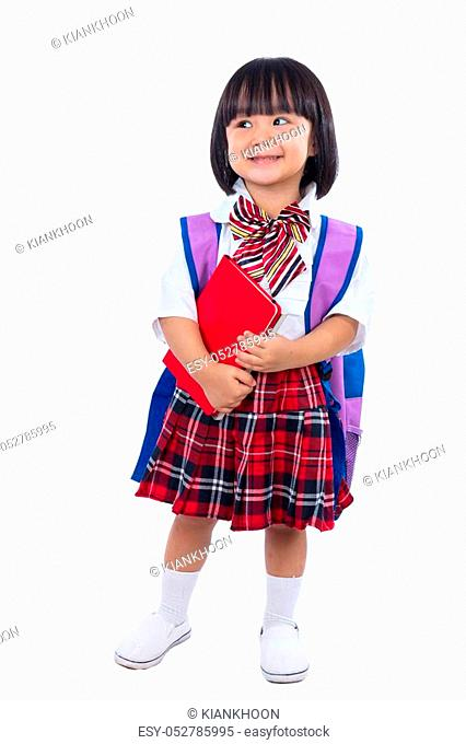 Happy Asian Chinese little student girl with school bag and books in isolated white background
