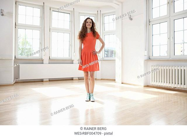 Woman standing in empty apartment