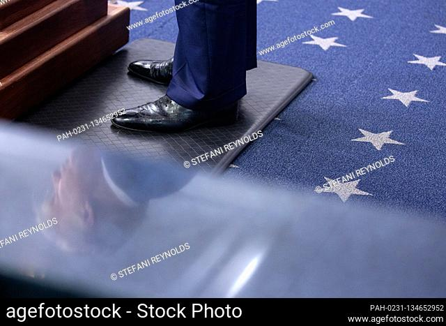 United States President Donald J. Trump is reflected as he speaks during a news conference in the James S. Brady Press Briefing Room at the White House in...
