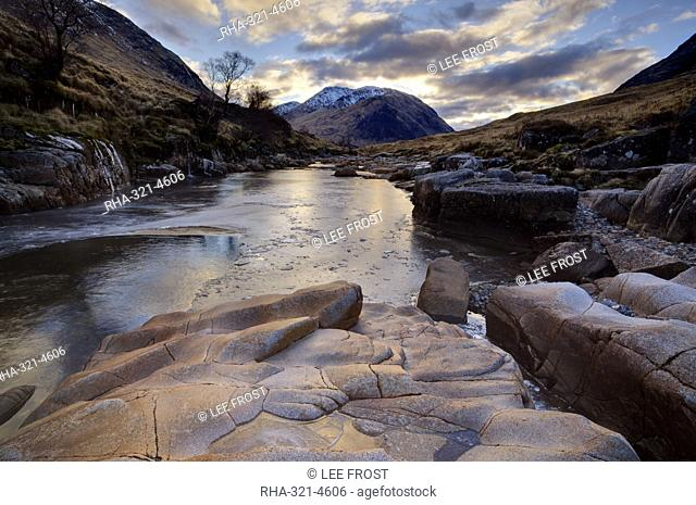 Winter view along partly-frozen River Etive towards distant mountains, Glen Etive, Rannoch Moor, near Fort William, Highland, Scotland, United Kingdom, Europe