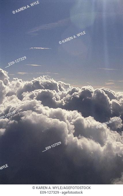 Tops of sunlit clouds seen from jet airplane