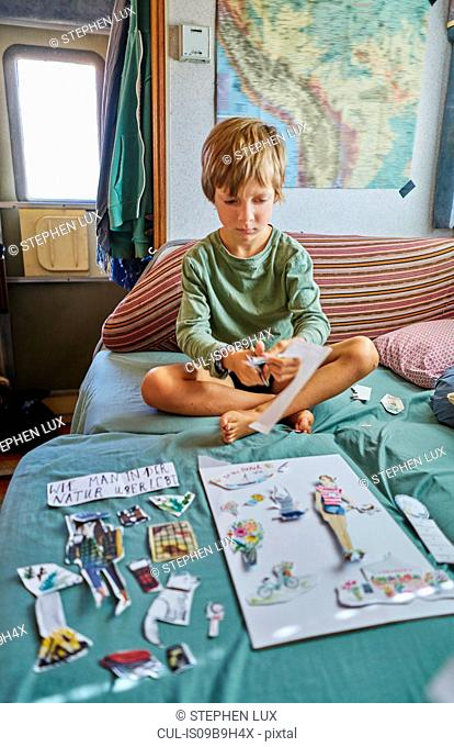 Boy cutting out pictures, Chuquisaca, Bolivia, South America