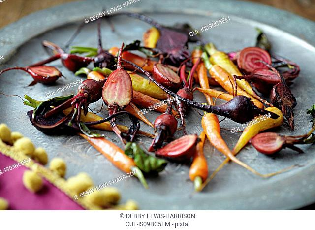 Roasted baby vegetables on tray