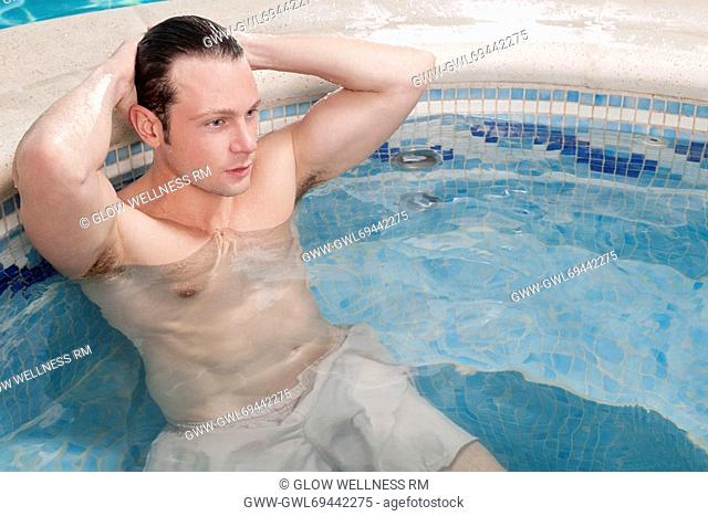 Man relaxing in a hot tub