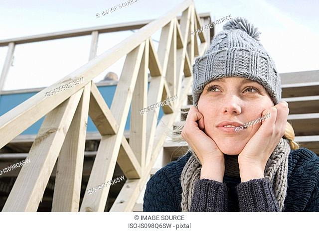 Young woman in a knit hat