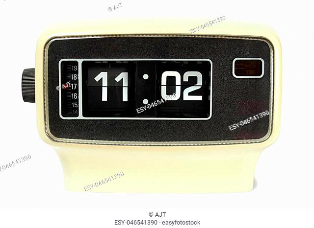 Vintage flip alarm clock on white background