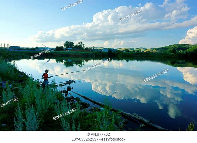 boy fishing on the lake