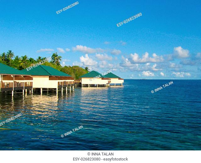 Over water bungalows and the blue sea and sky