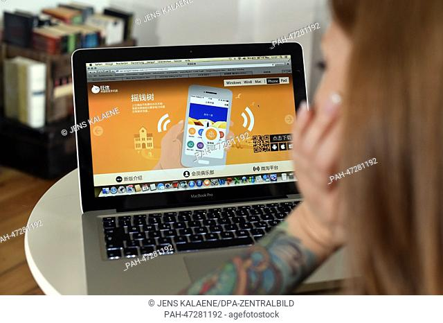ILLUSTRATION - A young woman browses on her notebook computer through the web page of Chinese online auction platform Taobao looking at online advertisement in...