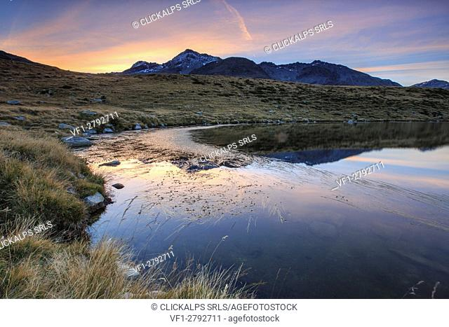 Peak Emet reflected in Lake Andossi at sunrise Chiavenna Valley Valtellina Lombardy Italy Europe