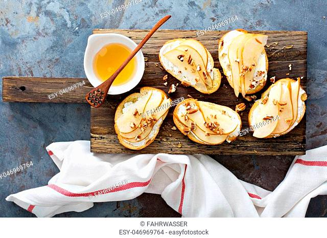 Pear bruschetta with cream cheese, nuts and honey