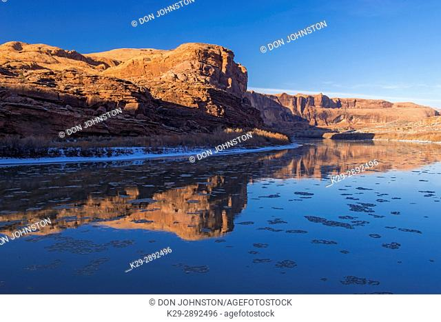 Winter reflections in the Colorado River, Arches National Park, Utah, USA