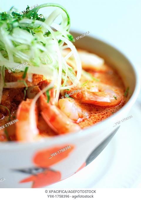 Laksa, a popular spicy noodle soup from Peranakan culture, which is a merger of Chinese and Malay elements found in Singapore