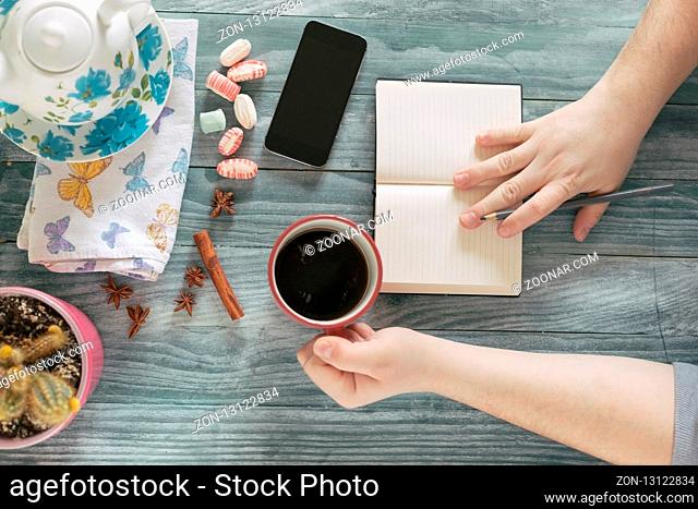 business man using mobile smart phone at wooden table , smart phone, cup of coffee
