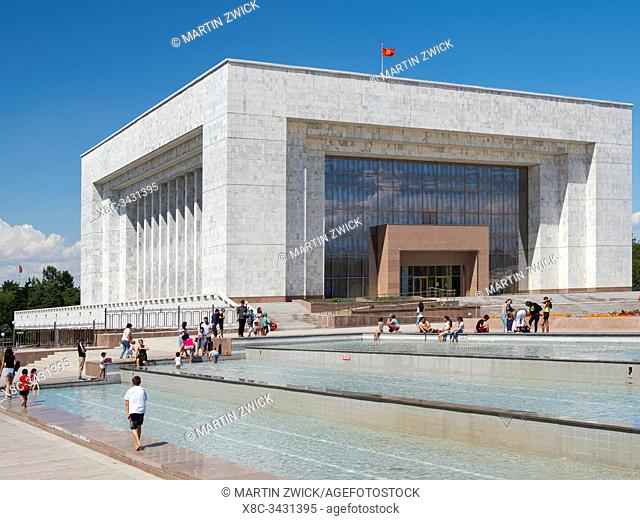 National Museum, visitors and locals on busy Ala Too square in the city center. The capital Bishkek located in the foothills of Tien Shan