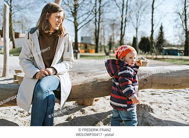 Mother with little daughter on a playground