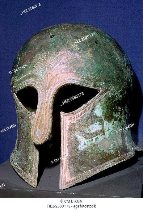 A bronze helmet of the Corinthian type, which protected the face and especially the cheek bones, but impaired the wearer's field of vision, 6th century BC