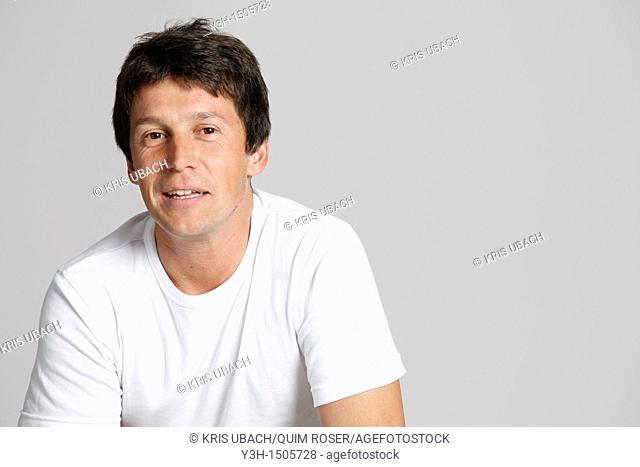 Studio shot of Argentinian man, looking at camera