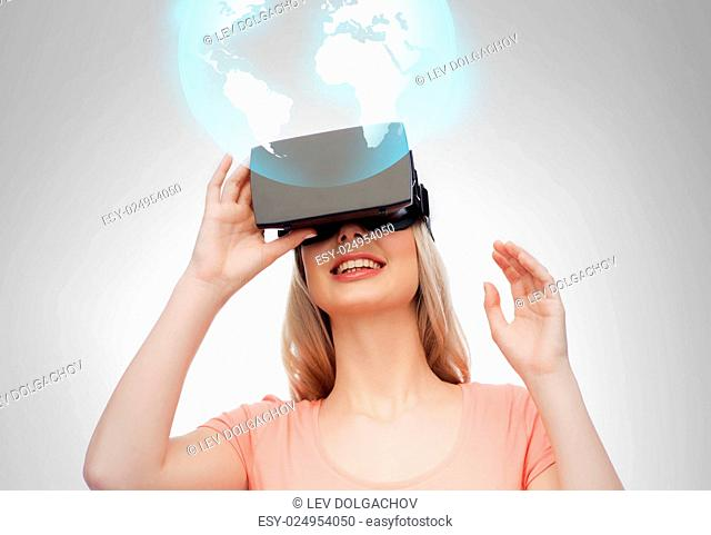 technology, augmented reality and people concept - happy young woman with headset or 3d glasses looking at virtual projection of earth globe