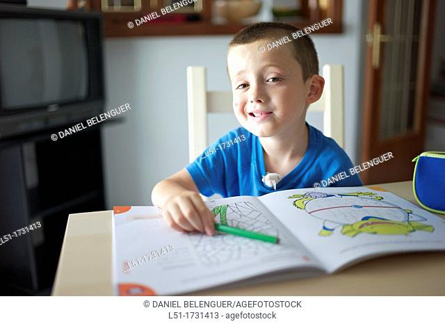 boy making fun while doing homework, Ludiente, Castellón, Spain