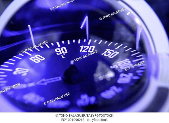 blue nautical compass closeup focus selective on east small focus depth