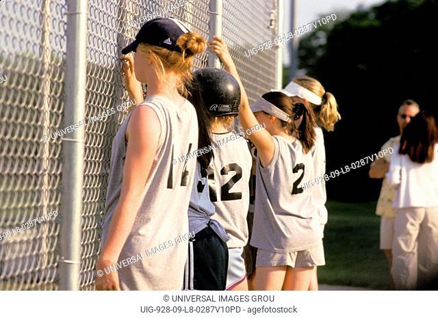 Illinois. Girls Softball Game. 11 Year Old Girls Waiting To Play