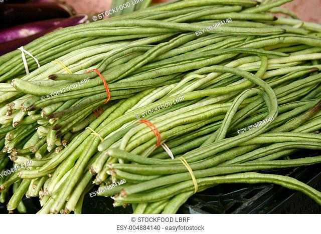 Bundles of Organic Chinese Long Beans on Display at a Farmer's Market