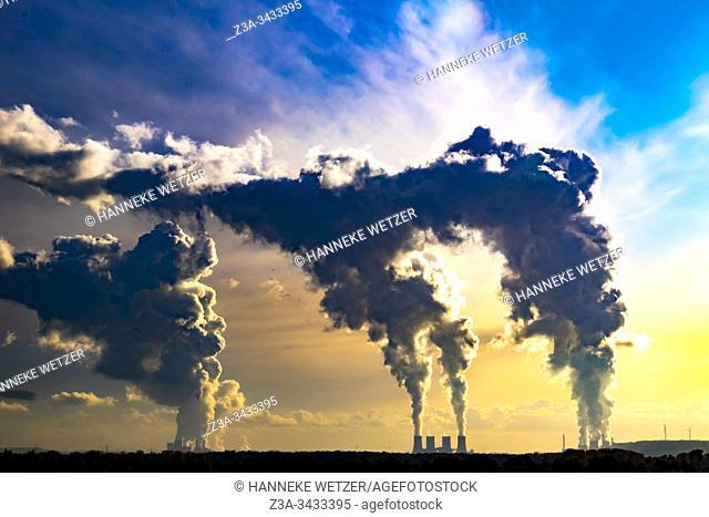 Colorful horizon with smoke of the Kraftwerk power plants of RWE Power, Ruhr area, North Rhine-Westphalia, Germany, Europe