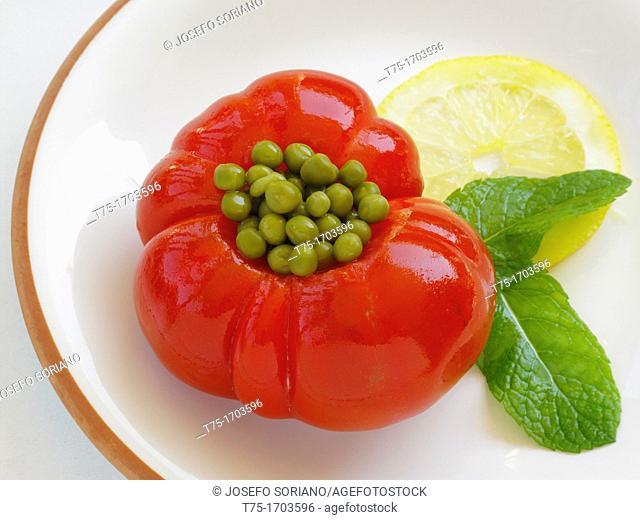 Tomato stuffed with peas, lemon and Mint