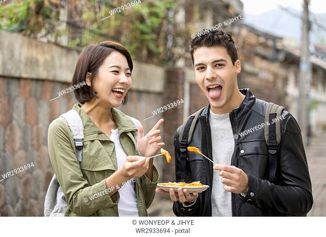 Young smiling couple tourists