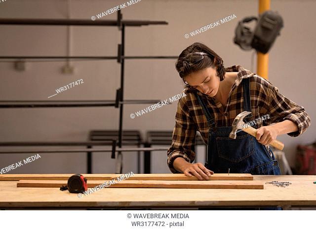 Female welder working in workshop