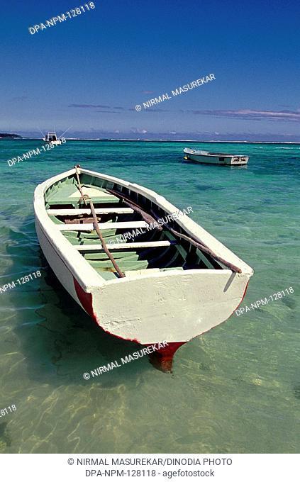 Empty Row boat floating ; Beach ; Flic-En-Flac ; Mauritius