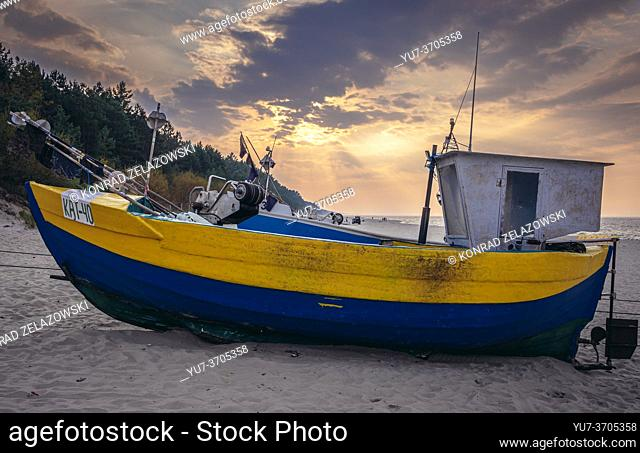 Fishing boat on a beach in Katy Rybackie on Vistula Spit over Gdansk Bay in the Baltic Sea, Poland