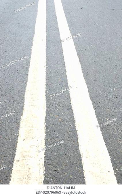 white lines on asphalt