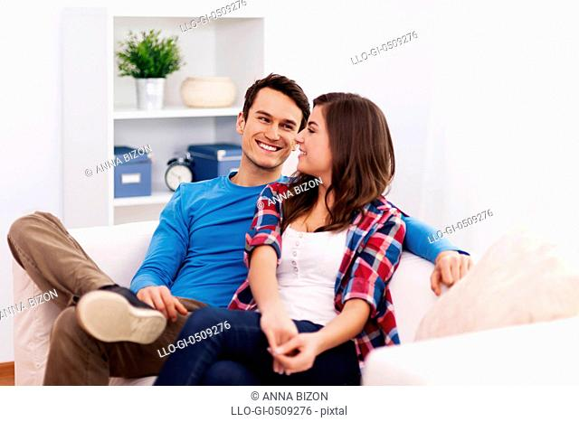 Loving couple sitting in living room Debica, Poland