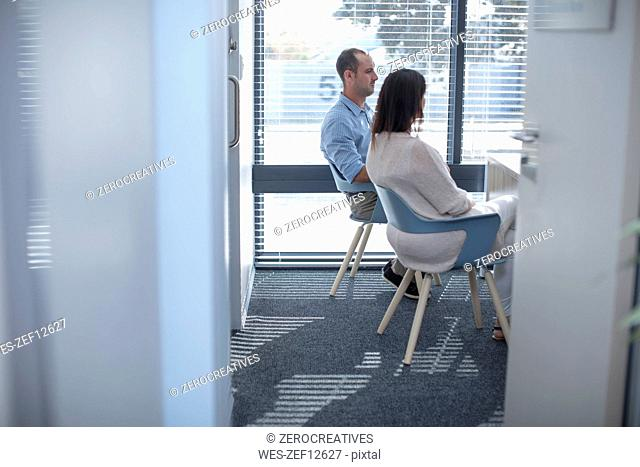 Couple sitting in consulting room at the doctor' s