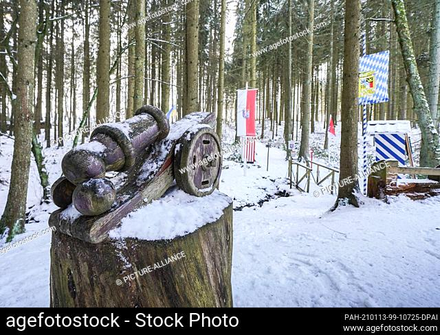 "13 January 2021, Hessen, Boxbrunn: A wooden cannon pointing in the direction of Hesse stands at the """"Bavaria Hesse Customs Office"""""